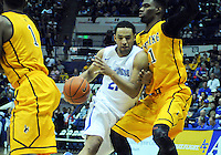 February 7, 2015 - Colorado Springs, Colorado, U.S. -  Air Force forward, DeLovell Earls #21, muscles his way through the lane during an NCAA basketball game between the University of Wyoming Cowboys and the Air Force Academy Falcons at Clune Arena, U.S. Air Force Academy, Colorado Springs, Colorado.  Air Force soars to a 73-50 win over Wyoming.