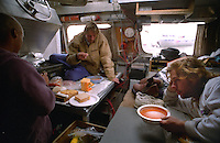 Eating a meal onboard the F/V Little Comfort.  (L to R) Ken Larson, Mike Ailor and skipper Mike Hayes June 25, -July 17, 1995.  Model released.
