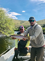 Courtesy photo<br /> The author (left) and guide Keith McGlothen wiht a 20-inch rainbow trout on Beaverhead River near DIllon, Mont.