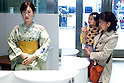 "Visitors greet to the Robot Aiko Chihira who debuts as a receptionist at the Nihonbashi Mitsukoshi department store on April 20, 2015, Tokyo, Japan. The robot is being employed for two days to share information with customers about store events and the food court, on April 20th and 21st. From April 22nd the robot will be on show at a ""Play the future with Toshiba"" exhibition held in the store showing how new technology may change future life-style and future department stores. (Photo by Rodrigo Reyes Marin/AFLO)"
