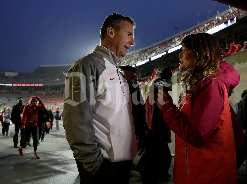 Ohio State Buckeyes head coach Urban Meyer is interviewed following a 56-17 win over the Rutgers Scarlet Knights at Ohio Stadium in Columbus. (Dispatch Photo by Barbara J. Perenic)