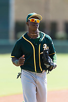 Oakland Athletics center fielder Lazaro Armenteros (13) jogs off the field between innings of an Instructional League game against the Los Angeles Dodgers at Camelback Ranch on September 27, 2018 in Glendale, Arizona. (Zachary Lucy/Four Seam Images)