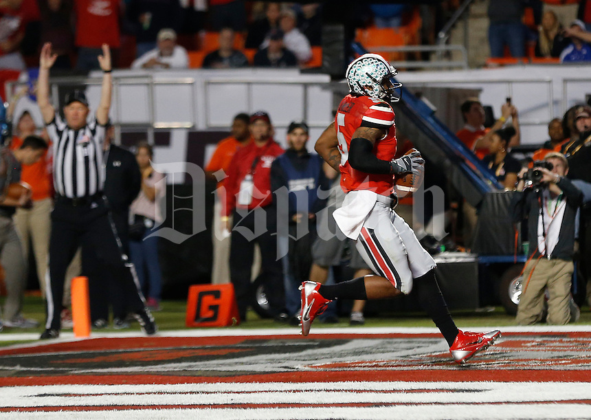 Ohio State Buckeyes quarterback Braxton Miller (5) runs for the go ahead touchdown in the second quarter of the Discover Orange Bowl between Ohio State and Clemson at Sun Life Stadium in Miami Gardens, Florida, Friday night, January 3, 2014. As of half time the Ohio State Buckeyes led the Clemson Tigers 22 - 20.(The Columbus Dispatch / Eamon Queeney)