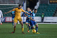Matthew Bloomfield of Wycombe Wanderers gets away from Ben Tozer of Newport County during the Sky Bet League 2 match between Newport County and Wycombe Wanderers at Rodney Parade, Newport, Wales on 22 November 2016. Photo by Mark  Hawkins.