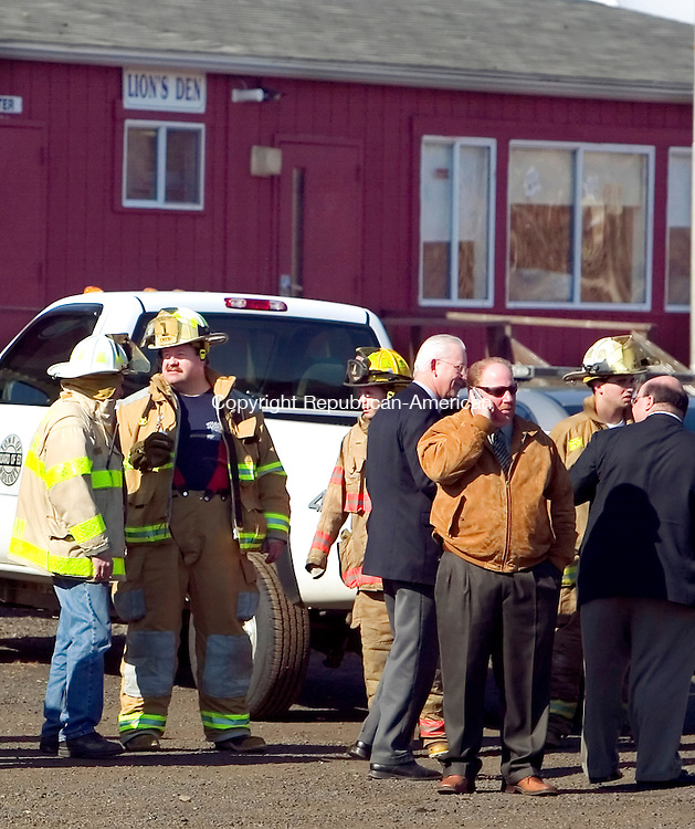 WOLCOTT, CT. 11 April 2007-041107SV02--At right (on the phone), Mayor Tom Dunn along with police, fire, and education dept. officials responded to a mercury spill at the alternative school on Todd Road in Wolcott Wednesday.<br /> Steven Valenti Republican-American