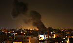 "Smoke billows rises following Israeli air strikes targeting Gaza City on November 13, 2018. Israel's military said it was carrying out air strikes ""throughout the Gaza Strip"" after a barrage of rocket fire from the Palestinian Gaza Strip towards Israel. The flare-up follows a clash that erupted during an Israeli special forces operation in the Gaza Strip the previous night that killed eight people of Hamas movement. Photo by Ashraf Amra"