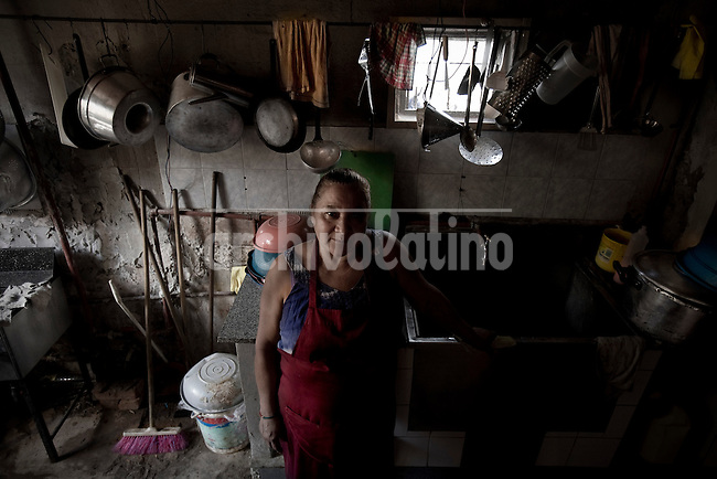 Photo essay on Buenos Aires Villa 21 slum in Barracas district, reputed as one of the more dangerous  of the city, but also a place where solidarity and friendship plays an important role helping the poor.In the picture Adela, cooker of the comunity kitchen soup Cambalache