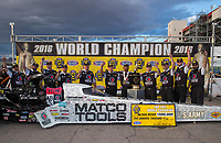 Oct 30, 2016; Las Vegas, NV, USA; NHRA top fuel driver Antron Brown and crew pose for a photo with the championship trophy as he celebrates after clinching championship during the Toyota Nationals at The Strip at Las Vegas Motor Speedway. Mandatory Credit: Mark J. Rebilas-USA TODAY Sports