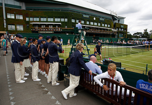 04.07.2016. All England Lawn Tennis and Croquet Club, London, England. The Wimbledon Tennis Championships Day 8. Match officials wait to go onto Court 5 today.