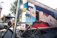 Titolo: Street Art,  Artista Jim Avignon<br /> Title Street Art, Artist Jim Avignon<br /> Una versione riveduta e corretta di un dipinto di Modigliani, Elvira, sua modella prediletta. Lungo le forme affusolate della 'desnuda', si srotolano linee immaginarie di autostrade. Citazionismo ironico che omaggia la grande figurazione italiana del '900, dissacrandola con garbo<br /> Roma 01-02-2015 Street Art a Roma. In vari quartieri di Roma e' fiorita la Street Art, con splendidi murales che hanno lo scopo di raccontare delle storie della citta', di commemorare dei momenti importanti, o semplicemente di interpretarla.<br /> Street Art in Rome. Very important writers  painted Murales in various districts of Rome to tell stories about the city, to commemorate important moments, to embellish the quarter or simply to portray it.  <br /> Photo Samantha Zucchi Insidefoto