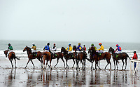 31-8-2014: The horses line up at the start with Eventual winner Rock Hopper with Jack Kennedy (yellow red cap) on the beach at the Glenbeigh Races on Rossbeigh Strand in County Kerry on Sunday.<br /> Picture by Don MacMonagle