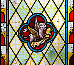 Winged ox or bull with wings symbol of Saint Luke nineteenth century stained glass window at Holy Trinity church, Easton Royal, Wiltshire, England, UK unknown artist