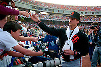 OAKLAND, CA - Dave Dravecky of the San Francisco Giants signs autographs before Game 2 of the 1989 World Series against the Oakland Athletics at the Oakland Coliseum in Oakland, California in 1989. Photo by Brad Mangin