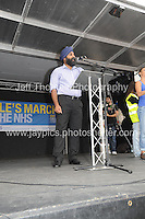 Peoples March for the NHS - Central London, Saturday 6th Sept 2014 - <br /> <br /> An NHS Doctor speaks at the rally<br /> <br /> <br /> <br /> <br /> Photographer: Jeff Thomas - Jeff Thomas Photography - 07837 386244/07837 216676 - www.jaypics.photoshelter.com - swansea1001@hotmail.co.uk