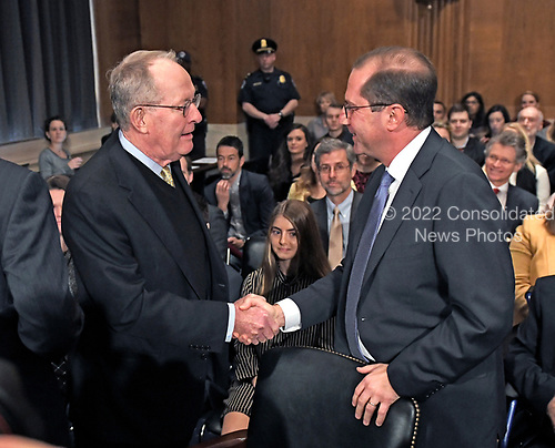 United States Senator Lamar Alexander (Republican of Tennessee), Chairman, US Senate Committee on Health, Education, Labor and Pensions, left, welcomes Alex M. Azar II, right, prior to hearing testimony before the committee on Azar's nomination to be Secretary of Health and Human Services on Capitol Hill in Washington, DC on Wednesday, November 29, 2017.<br /> Credit: Ron Sachs / CNP