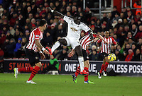 Pictured: Bafetimbi Gomis of Swansea heads the ball over James Ward Prowse of Southampton Sunday 01 February 2015<br /> Re: Premier League Southampton v Swansea City FC at ST Mary's Ground, Southampton, UK.