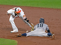 Baltimore Orioles shortstop Manny Machado (13) tags out New York Yankees shortstop Didi Gregorius (18) in the ninth inning of their game at Oriole Park at Camden Yards in Baltimore, MD on Tuesday, July 10, 2018.  The Orioles won the game 6 - 5.<br /> Credit: Ron Sachs / CNP<br /> (RESTRICTION: NO New York or New Jersey Newspapers or newspapers within a 75 mile radius of New York City) Credit: Ron Sachs/MediaPunch
