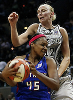 San Antonio's Ann Wauters (12) crashes into Detroit's Kara Braxton (45) during Game 2 of the WNBA Finals between the Detroit Shock and the San Antonio Silver Stars, Oct. 3, 2008, at the AT&T Center in San Antonio. Detroit won 69 - 61 to go up 2 - 0 in the best-of-five series. (Darren Abate/pressphotointl.com)
