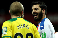 1st January 2020; Carrow Road, Norwich, Norfolk, England, English Premier League Football, Norwich versus Crystal Palace; James Tomkins of Crystal Palace speaks with Teemu Pukki of Norwich City - Strictly Editorial Use Only. No use with unauthorized audio, video, data, fixture lists, club/league logos or 'live' services. Online in-match use limited to 120 images, no video emulation. No use in betting, games or single club/league/player publications