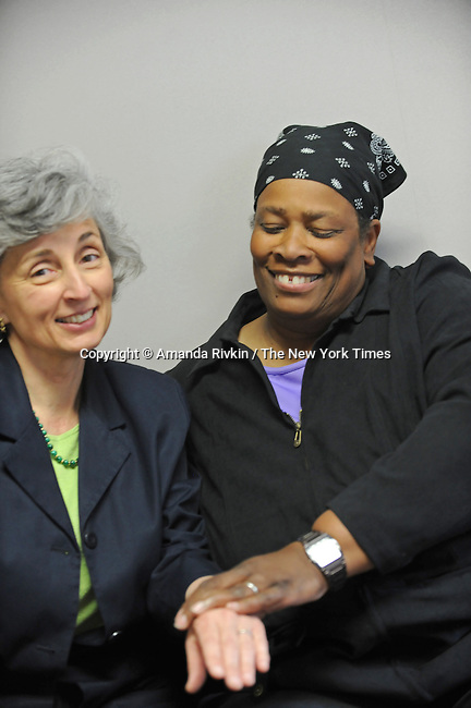 Veronika Kolder, 52, and Roxanne Latimer, 54, of Iowa City wait for their marriage license at the Johnson County Recorder's Office the first day same sex weddings are legal across Iowa in Iowa City, Iowa on April 27, 2009.  Kolder and Latimer have been together for 17 years, exchanging rings they purchased in Austria in 1995 the same year in a commitment ceremony; the two met when Latimer, who is originally from New York, was Kolder's mail carrier in the north side Chicago neighborhood of Rogers Park.