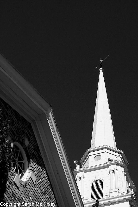 Looking up at the spire and brick gable of the Ukiah Methodist Church in Mendocino County in Northern California.