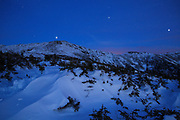 Franconia Ridge at night blue hour from along Greenleaf Trail in the New Hampshire White Mountains during the winter months. Greenleaf Trail leads to the summit of Mount Lafayette (left, center). And the Appalachian Trail travels across this ridge.