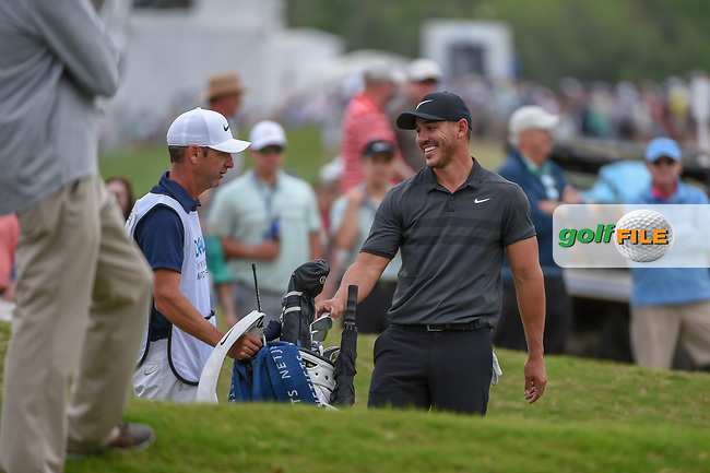 Brooks Koepka (USA) shares a laugh with his caddie near the green on 12 during day 3 of the WGC Dell Match Play, at the Austin Country Club, Austin, Texas, USA. 3/29/2019.<br /> Picture: Golffile | Ken Murray<br /> <br /> <br /> All photo usage must carry mandatory copyright credit (© Golffile | Ken Murray)