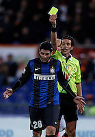 Calcio, semifinale di andata di Coppa Italia: Roma vs Inter. Roma, stadio Olimpico, 23 gennaio 2013..Referee Andrea De Marco, right, gives a yellow card to FC Inter defender Cristian Chivu, of Romania, during the Italy Cup football semifinal first half match between AS Roma and FC Inter at Rome's Olympic stadium, 23 January 2013..UPDATE IMAGES PRESS/Isabella Bonotto