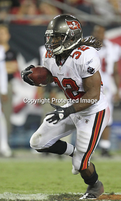 Tampa Bay Buccaneer's running back Kareem Huggins runs for a first down against the Kansas City Chiefs. The Buccaneers defeated the Chiefs 20-15 during an NFL preseason game Saturday, Aug. 21, 2010 in Tampa,Fla. (AP Photo/Margaret Bowles).