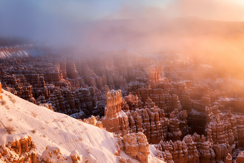 Fog rolling over Inspiration Point at sunrise. Bryce Canyon National Park, UT