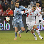 Ilie Sanchez (left) of Sporting KC and Emmanuel Gigliotti of Toluca vie for the ball during their CONCACAF Champions League game on February 21, 2019 at Children's Mercy Park in Kansas City, KS.<br /> Tim VIZER/Agence France-Presse