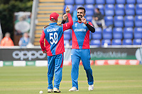 Dawlat Zadran (Afghanistan) celebrates with Hashmatullah Shahidi  (Afghanistan) following the dismissal of Lasith Malinga (Sri Lanka) during Afghanistan vs Sri Lanka, ICC World Cup Cricket at Sophia Gardens Cardiff on 4th June 2019