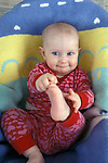 Berkeley CA Baby girl, five-months-old, happily playing with feet MR