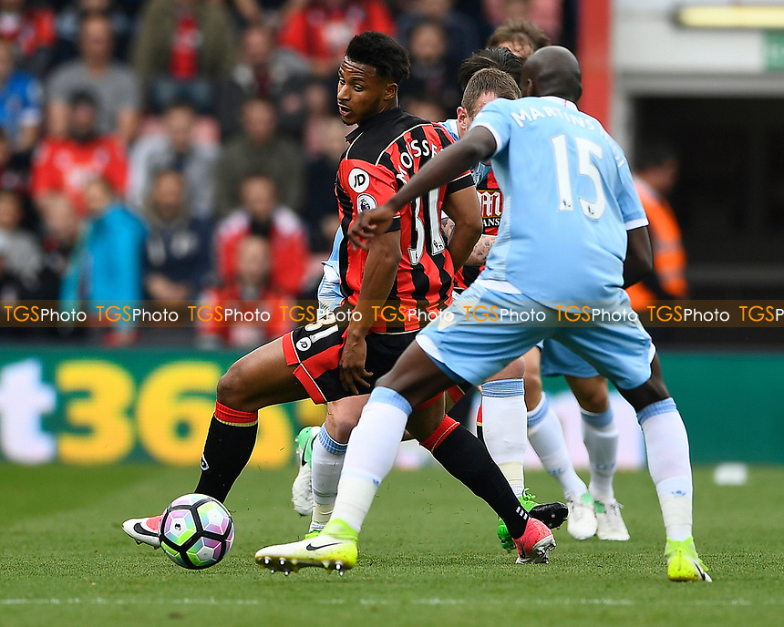 Lys Mousset of AFC Bournemouth looks to turn Bruno Martins Indi of Stoke City during AFC Bournemouth vs Stoke City, Premier League Football at the Vitality Stadium on 6th May 2017