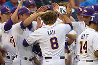 LSU Tiger first baseman Mason Katz (8) is greeted by his teammates after he hit a home run during Game 4 of the 2013 Men's College World Series against the UCLA Bruins on June 16, 2013 at TD Ameritrade Park in Omaha, Nebraska. UCLA defeated LSU 2-1. (Andrew Woolley/Four Seam Images)