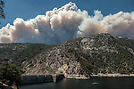 Rim fire reaches Yosemite National Park as smoke looms over O'Shaughnessy Dam.  The dam and reservoir serves as the primary water source for the Hetch Hetchy Project.