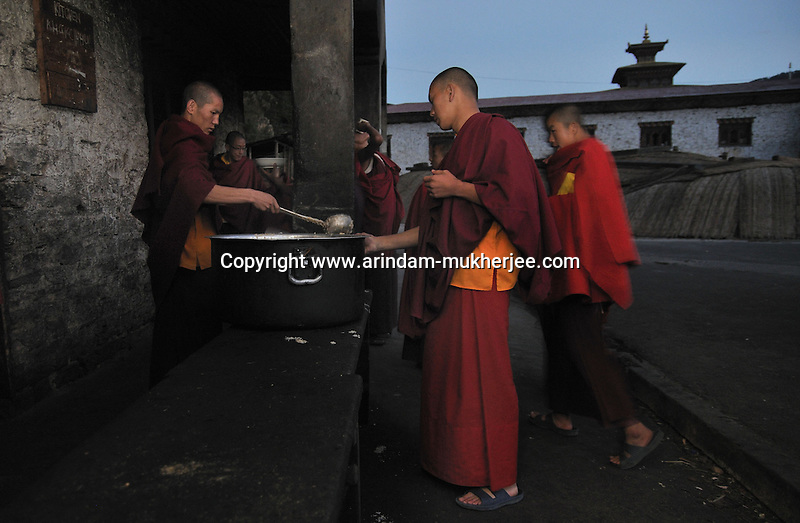 Lamas, who are students of Kharchhu Monastry (which is a buddhist school and college) having their dinner in the evening. These lamas lead a very modest life and have simple food three times a day. Arindam Mukherjee....