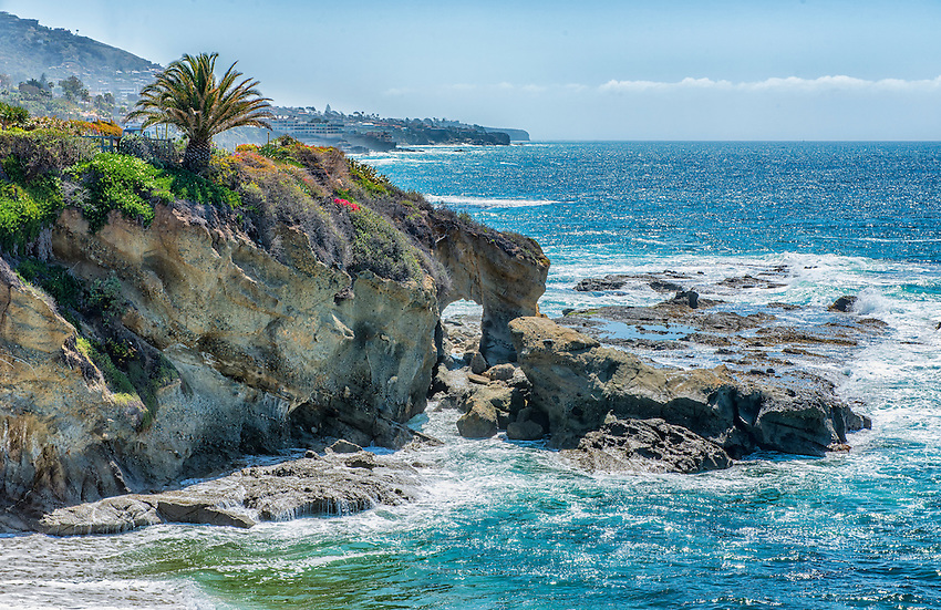 A stone arch carved by the Pacific Ocean marks the coast of California at Montage Laguna Beach, in Orange County