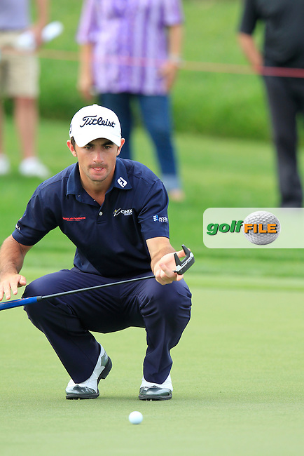 Gary Stal (FRA) lines up his putt on the 13th green during Sunday's Final Round of the Abu Dhabi HSBC Golf Championship 2015 held at the Abu Dhabi Golf Course, United Arab Emirates. 18th January 2015.<br /> Picture: Eoin Clarke www.golffile.ie