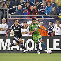 Seattle Sounders midfielder Lamar Neagle (27) dribbles as New England Revolution midfielder Ryan Guy (13) closes. In a Major League Soccer (MLS) match, the Seattle Sounders FC defeated the New England Revolution, 2-1, at Gillette Stadium on October 1, 2011.