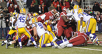 NWA Media/ANDY SHUPE - Arkansas' Jonathan Williams (32) leaps over the LSU line and into the end zone during the second quarter Saturday, Nov. 15, 2014, at Razorback Stadium in Fayetteville.