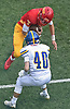 Anthony Pecorella #7, Chaminade quarterback, lowers his shoulder on a keep as Peter Taliercio #40 of Kellenberg closes in on him during the third quarter of an NSCHSAA varsity football game at Chaminade High School in Mineola on Sunday, Oct. 14, 2018. Kellenberg won by a score of 42-14.