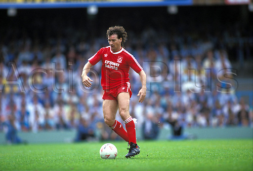 August 1987: Full length image of Liverpool midfielder CRAIG JOHNSON with the ball Photo: Tony Henshaw/Action Plus...soccer football player 8708
