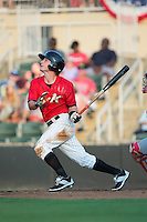 Grant Massey (16) of the Kannapolis Intimidators follows through on his swing against the Hagerstown Suns at Kannapolis Intimidators Stadium on July 4, 2016 in Kannapolis, North Carolina.  The Intimidators defeated the Suns 8-2.  (Brian Westerholt/Four Seam Images)