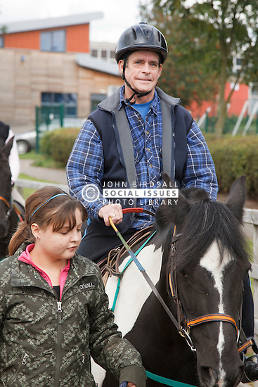 Man with visual impairment having riding lesson.