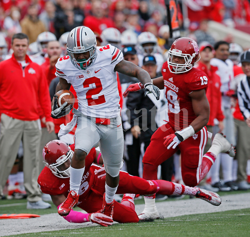 Ohio State Buckeyes running back Dontre Wilson (2) breaks away from Indiana Hoosiers linebacker Zeke Walker (6) and Indiana Hoosiers defensive back Tony Fields (19) in the first of the Ohio State Buckeyes against the Indiana Hoosier at Memorial Stadium in Bloomington Indiana Oct. 3, 2015.(Dispatch photo by Eric Albrecht)