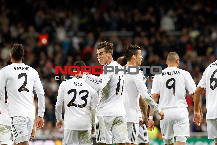 Gareth Bale of Real Madrid scores during La Liga match between Real Madrid and Sevilla at Santiago Bernabeu stadium in Madrid, Spain. October 30, 2013. Foto © nph / Caro Marin)
