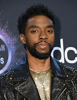 24 November 2019 - Los Angeles, California - Chadwick Boseman. 2019 American Music Awards - Press Room held at Microsoft Theater. Photo Credit: Birdie Thompson/AdMedia