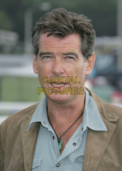 PIERCE BROSNAN.A Day at the Beach and Paddle Out Protest against the proposed Liquid Natural Gas Facility Construction held at Malibu Surfrider Beach, Malibu, California, USA,.22 October 2006..portrait headshot beige brown jacket trousers blue shirt funny mouth open.Ref: ADM/RE.www.capitalpictures.com.sales@capitalpictures.com.©Russ Elliot/AdMedia/Capital Pictures.