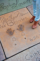 Grauman's, Chinese, Theatre,  Womans Shoes, Feet,  Standing,  Movie Stars, Hand - Footprint, Impressions, Hollywood,  CA